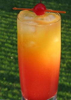 ~ Beach Breeze ~ 1 oz. Strawberry Rum ~ 1 oz. Pineapple Rum ~ 1 oz. Coconut Rum ~ 2 oz. Orange Juice ~ 2 oz. Pineapple Juice ~ 1 oz. Grenadine ~ Cherry for garnish ~