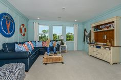 Add light blue paneling to channel the coastal feel. Ryland | Admiral Pointe | MiraBay