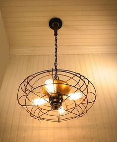 Pendant light from Industrial fan. source: LampGoods, etsy Cleverly hand-crafted out of a vintage and bladeless fan and fashioned with Edison lights, this pendant lamp is cool in a whole other way. Edison Lighting, Rustic Lighting, Industrial Lighting, Vintage Lighting, Home Lighting, Lighting Ideas, Bathroom Lighting, Modern Lighting, Edison Light Chandelier