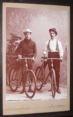 Men with bicycles wearing hats Antique cabinet photo from victorian age