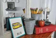 back to school mantel - dictionary, pencils, flashcards, candlestick