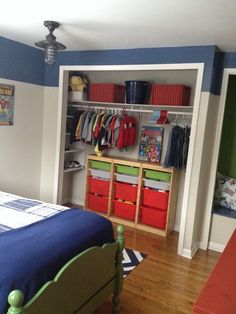 Little boy's bedroom closet. When you're clean and organized, you don't necessarily need closet doors!
