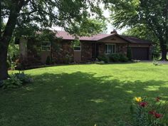 Beautiful Landscaping, great back yard with patio's, firepit, guest house and outbuilding! Nice neighborhood near all schools and golf course. Perfect family home, has a lot to offer! in Marshfield MO