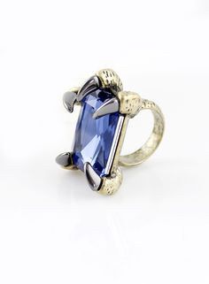 Blue Gemstone Gold Claw Ring US$6.85 - This is a cute and unique ring