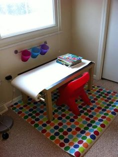 DIY kids craft table - suspicious link but the photo says it all....need table with thicker legs, and towel rack.