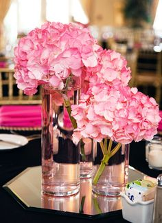 Three vases and three blooms. That's all this is. Purchase vases in three different heights (these range from 4-in. to 8-in.) then clip three stems to create levels. (This is Seaside Serenade® Hamptons hydrangea.)