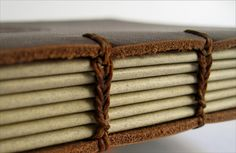 Forget the boards and paring--sew straight onto the leather, love this a leather book and you can see the stitching!!!