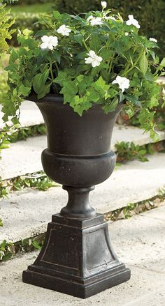 Dress up your entryway with our Genevieve Urn. Fill it with your favorite blooms and greenery.