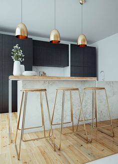 Kitchen on Behance High table with golden bar stools and pendants