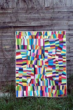 """Check out this stunning and bright """"oodalolly"""" quilt by Rachel of Stitched In Color."""