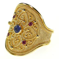 Damaskos Broad Ruby and Sapphire Ring,18k Gold, Rubies and a Sapphire. Athena's Treasures: http://www.athenas-treasures.com/
