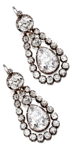 A Pair of Antique Silver-Topped Gold and Diamond Pendant-Earrings, Last Quarter 19th Century. The articulated swing centres set with 2 pear-shaped diamonds, the tops set with 2 antique cushion-shaped diamonds, further set with smaller antique cushion-shaped diamonds, the removable articulated surrounds set with old mine diamonds. #antique #earrings