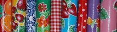 So, what is Mexican Oilcloth?  It's a highly durable, double PVC coated fabric. 91% PVC, 6% Polyester and 3% cotton. The ink is printed in the first coat of PVC, not onto the fabric backing. This is then coated with a clear layer of PVC, making the oilcloth fade resistant, stain resistant and it simply wipes clean. Mexican Oilcloth is famous throughout the world for its practical qualities and gorgeous colours and patterns.    What can you do with it?  Mexican Oilcloth is suitable for…