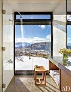 A shower in an Olson Kundig Architects–designed Washington State vacation home is equipped with fittings by Chicago Faucets, and has spectacular views of the Cascade Mountains.