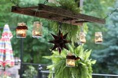turn an old ladder into a light fixture or a pot rack
