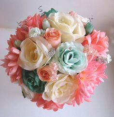 ~~~ FREE SHIPPING for a limited time ~~~  presenting our newest bouquet collection ROSES & DREAMS, consisted of Top quality and realistic handmade wedding bouquets, boutonnieres and corsages complimented by the latest trends in accessories, feathers, sparkling beads and luxurious ribbons.  This listing is for a 17 pc package which includes the following items:  1 Brides Round bouquet (10 round ) made with Cream, Peach and Coral roses, Coral Peonies, Mint green and Teal roses, few Peach ro...