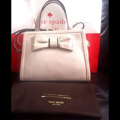 """💥SALE💥♠️Kate Spade Dominique Bow Front Satchel♠️ Brand new with tags and dustbag. Beautiful cream color pebbled leather 'Dominique' bag by Kate Spade. Adorable bow accent on front highlighted by black trim. Rolled leather top handle and adjustable shoulder/crossbody strap. Measures approximately 12""""x9""""x6"""". kate spade Bags Satchels"""