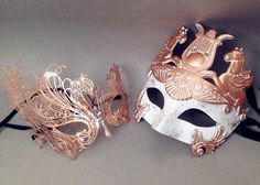 This masquerade mask pair is beautifully made for couple, the male Roman gladiator mask is made from resin and finished with paper plaster on the
