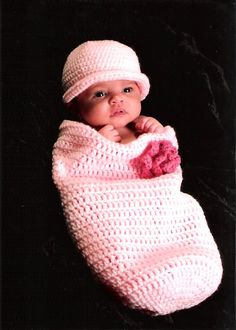 Pattern includes newborn and 0-3 month size. Also includes hat and flower pattern.