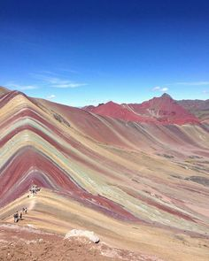 Can you spot @burkathon and his friends feeling tiny walking along the Rainbow Mountain of Vinicunca Peru?  This phenomenal landscape lies just off the Ausangate trek in the Cusco region of Peru.  Tag a friend and start planning! #discoversouthamerica by discoversouthamerica