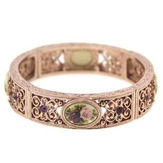 This Manor House, Victorian inspired stretch bracelet, features rose gold tone filigree, amethyst purple crystals and vintage floral motif stones.