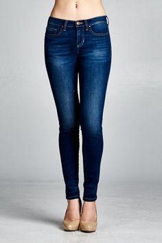 Dark denim distressed skinny jeans