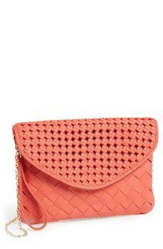 Love this coral woven faux leather clutch!
