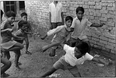 Boys playing.. From Duke Digital Collections. Collection: William Gedney Photographs and Writings. Featured in What Was True: The Photographs and Notebooks of William Gedney, edited by Margaret Sartor, coedited by Geoff Dyer. Mark: Stamp. Date of print: 1974 Jan..