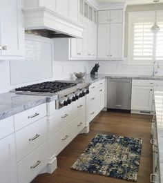 The countertops are Super White Quartzite and the cabinets are painted Benjamin Moore White Cloud. Quartzite Countertops, Kitchen Countertops, Veranda Interiors, Cloud Kitchen, Compound Wall Design, White Master Bathroom, Mudroom Cabinets, Wood Barn Door, Living Room Decor Inspiration