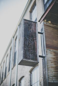 An old sign outside of our home, the historic Feathbone Factory. journeymandistillery.com