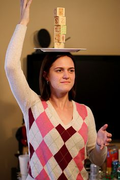 Minute to Win It games - stack blocks on a plate on your head while looking in a mirror