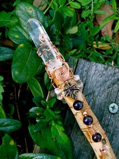 WAS 55.99 NOW 45.99! Sale ends 4/11/12 This wand is so unusual! While I was walking under a large Maple tree I found this gorgeous branch on the grass. There was something magical about it! Instantly I knew that it would make a beautiful wand devoted to the Goddess! I wrapped the maple wood with brass wire and place a long bright quartz point on the tip. With a thinner brass I threaded moonstone, labradorite, amethyst, and baltic amber beads. I decided to keep the bottom bare to ...