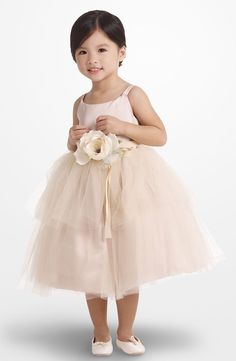 The sweetest flower girl dress! Simple and high-quality. Love the soft pink tulle skirt and detachable flower belt. Adorable for any wedding.
