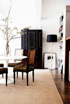A modern, black and white dining space with gorgeous branches as centerpiece // the home of fashion designer Peter Som