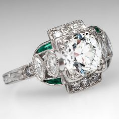 1930's Art Deco Engagement Ring featuring an Old European cut diamond and green glass accents, set in platinum