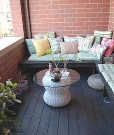 apartment balcony..buy benches and add seat cushions and throw pillows for back support
