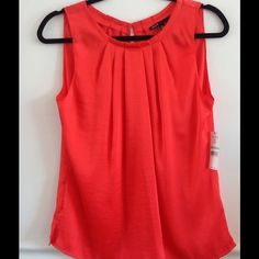 Chaus coral top NWT, go Broncos! Chaus coral orange top with ruffled front and hook on back. Go Denver Broncos! chaus Tops