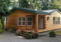 The plank siding was replaced with cedar log siding for a cozy cabin feel. Project completed by Modulog Industries, Inc.