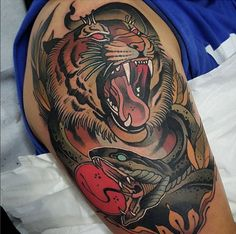 Yallzee's tattoo of the day done by tattoo artist Toni Donaire #inked #ink #tattoo #yallzee #pick #tiger #color