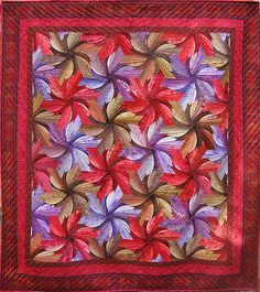 Day Lilies by Val Moore (Sydney, Australia)  Day Lilies is a quilt pattern of tessellating, or interlocking shapes designed by Jinny Beyer