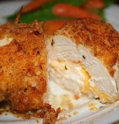 Not your everyday chicken dish! Stuffed with Cheddar and cream cheeses, then drenched with a garlic-lemon-butter sauce, your friends and family will be begging you to make this recipe.