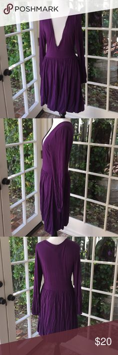 Purple vneck dress From shoulder to bottom measures 33 inches. Pit to pit measures 18 inches. Vneck measures 12 inches long so a tank would be great underneath! From waist to bottom is 20 inches. Last picture shows how skirt is bunched under to add depth. 95% viscose and 5% spandex. wilster Dresses Long Sleeve