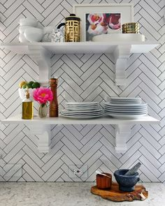 The open shelving and decorative corbel shelf supports Kristin chose have a dual function: It is a stylish alternative to regular cabinets and shelving, and it offers easy access to ... anything and everything. No more rummaging through cluttered cabinetry!(For more on Martha Stewart Living kitchens, visit The Home Depot.)