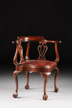 A CHIPPENDALE STYLE CARVED MAHOGANY CORNER CHAIR, BY SOUTHWOOD : Lot 270