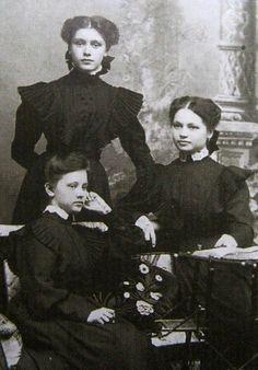 Russian school uniform. Three Russian  schoolgirls in casual uniform dresses. Early 20th century. #education