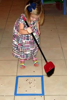 """Help develop gross motor skills by encouraging sweeping. Sweeping into a taped square is a great idea ("""",)"""