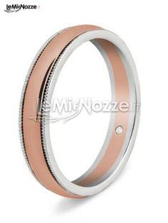 http://www.lemienozze.it/operatori-matrimonio/gioielli/fedi-per-il-matrimonio/media/foto/5  Fede nuziale bicolore con diamantino interno