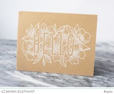 Here, I white embossed the image onto kraft cardstock then took a white colored pencil and gave the florals some shading. It really made the HELLO stand out ...