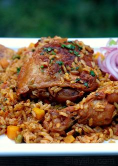Recipe for arroz con pollo or Latin sytle chicken rice made with chicken and rice cooked in a broth of onions, tomatoes, peppers, celery, garlic, spices, and herbs.