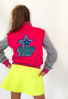 70d6d1914ba Channel your inner superstar by brightening things up a bit with this bold  varsity jacket from
